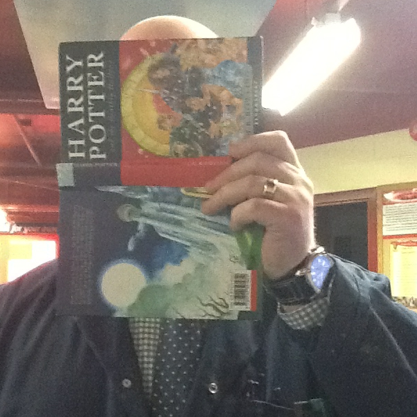 Staff member with book